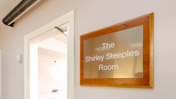 Brass plaque inscribed with The Shirley Steeples Room